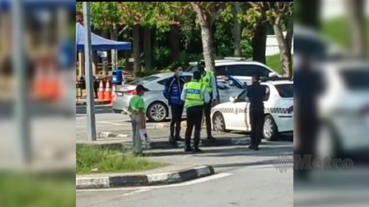 Pihak polis menjalankan siasatan terhadap lelaki yang berlegar-legar di R&R Bukit Gantang. FOTO Ihsan Pembaca