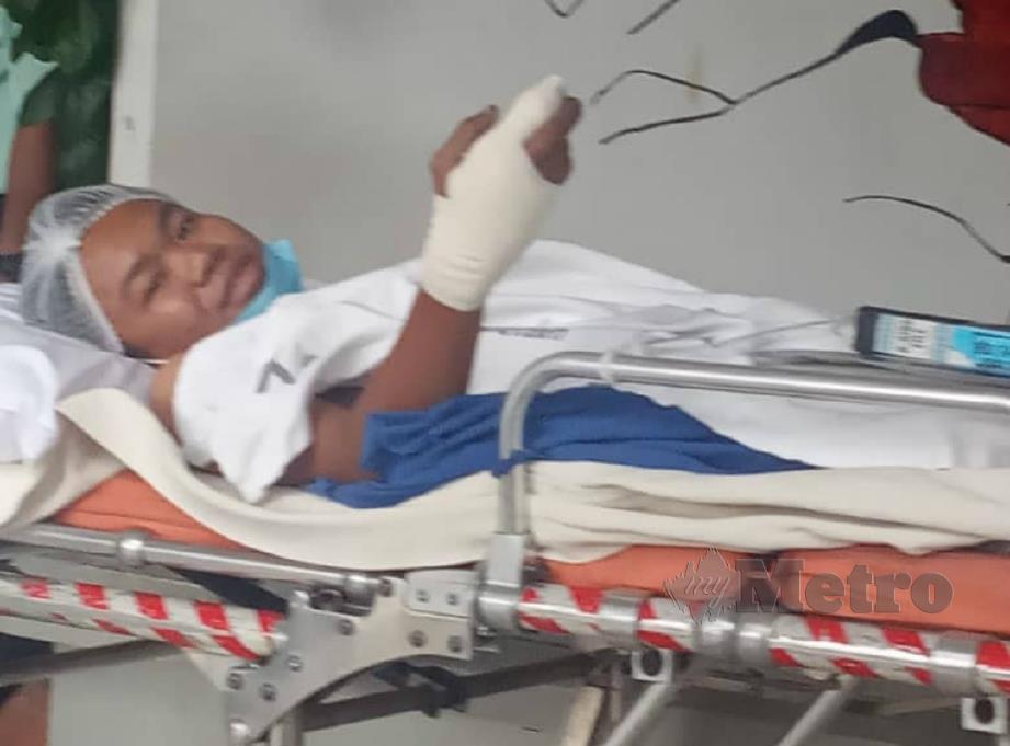 Keadaan Mohammad Firdaus kini stabil selepas menjalani pembedahan di Hospital Taiping. FOTO Ihsan keluarga