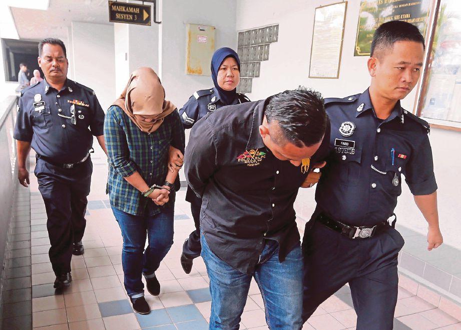 MOHD Faizal dan Nursir Elyana dibawa keluar dari mahkamah.