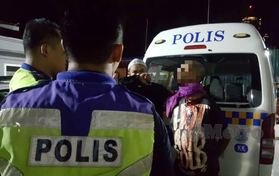 Suspek diberkas pasukan polis selepas cuba melarikan diri. FOTO Junaidi Ladjana