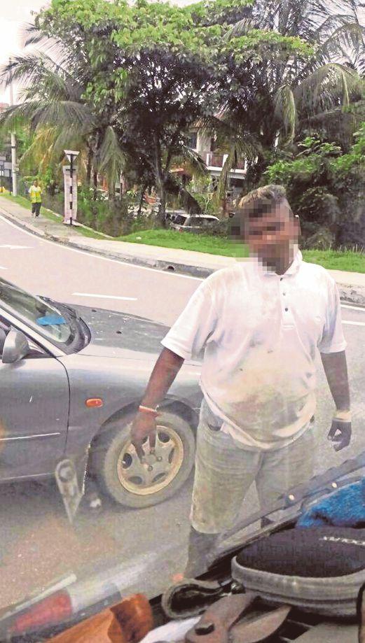 seorang suspek yang  menghalang lori MPKj.