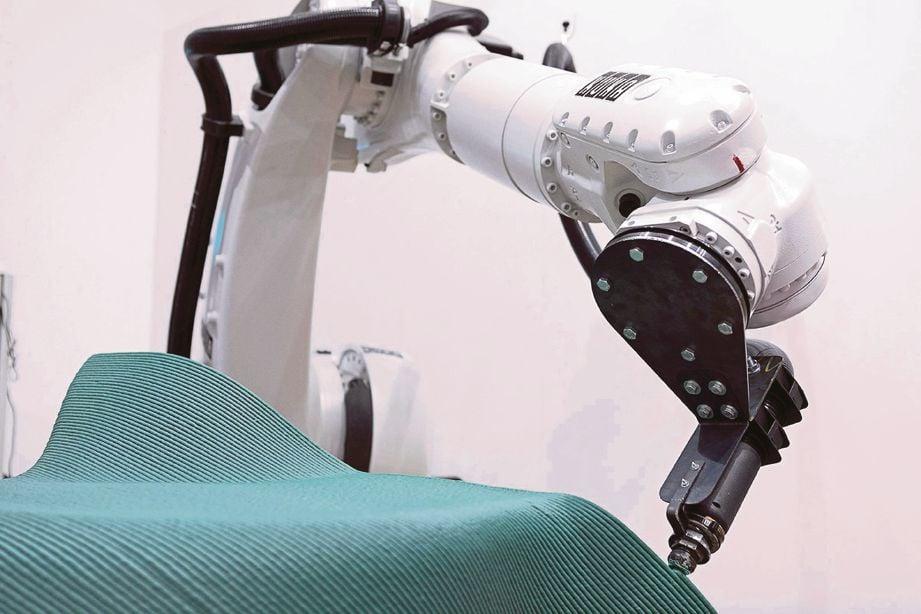 ROBOT 3D bekerja menghasilkan rekaan dipilih.