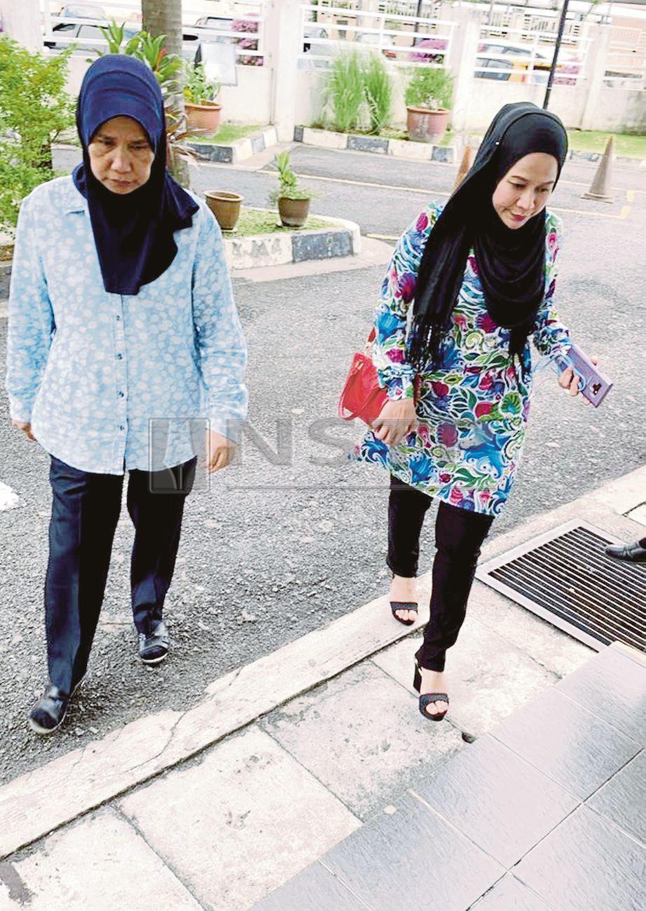NABILA (kanan) tidak mengaku bersalah di atas tuduhan pecah amanah membabitkan nilai RM5 juta empat tahun lalu.