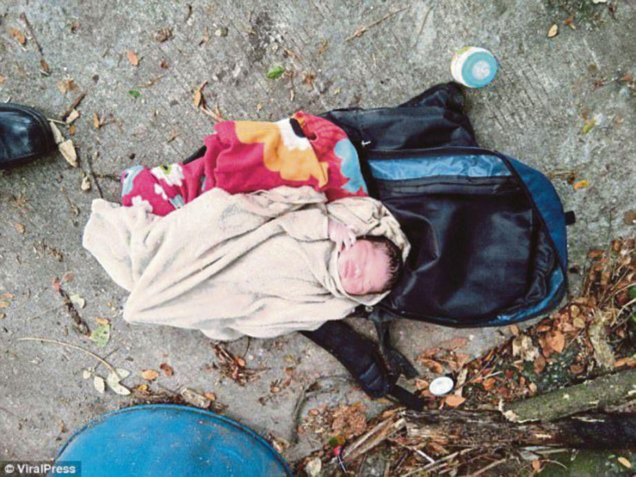 KEADAAN bayi perempuan yang ditemui dibuang di dalam tong sampah di Chiang Mai, Thailand pada Ahad lalu. - Agensi