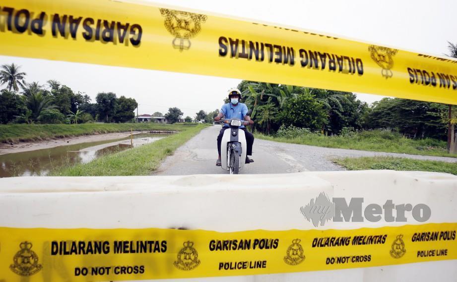 JALAN ke Pida 1, Kubang Pasu, Kedah yang ditutup bagi membendung penularan wabak Covid-19 yang dikaitkan dengan Kluster Sivagangga. FOTO arkib NSTP