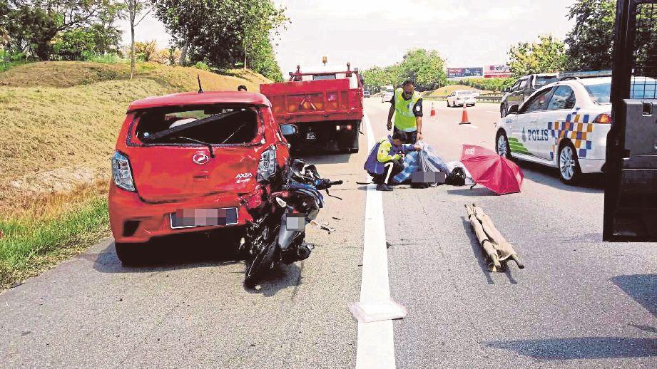 LOKASI kemalangan maut di Kilometer 218, Lebuhraya Utara-Selatan (PLUS) arah selatan, semalam.