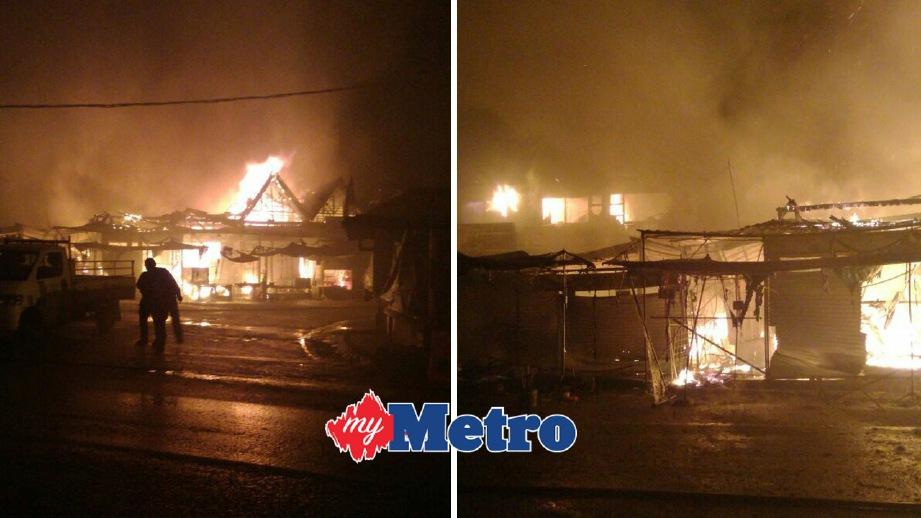 ANGGOTA bomba berusaha memadamkan kebakaran.FOTO ihsan Bomba