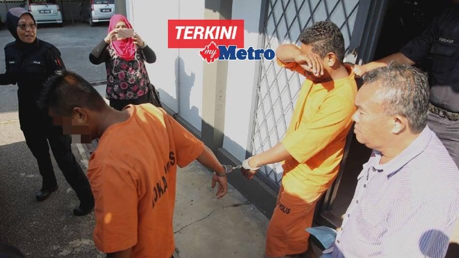 Dua lelaki yang ditahan dibawa keluar dari Mahkamah Majistret Jitra setelah mendapat perintah tahanan reman. FOTO Sharul Hafiz Zam