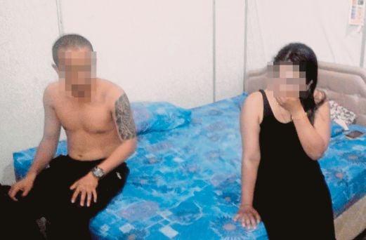 Isteri orang bergaun hitam dicekup bersama abang tentera