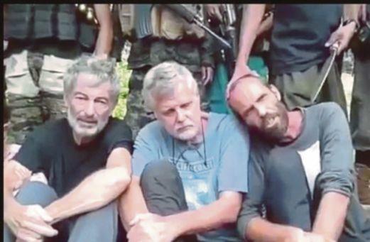 DUA lelaki warga Kanada dan seorang warga Norway yang kini diculik militan Abu Sayyaf.