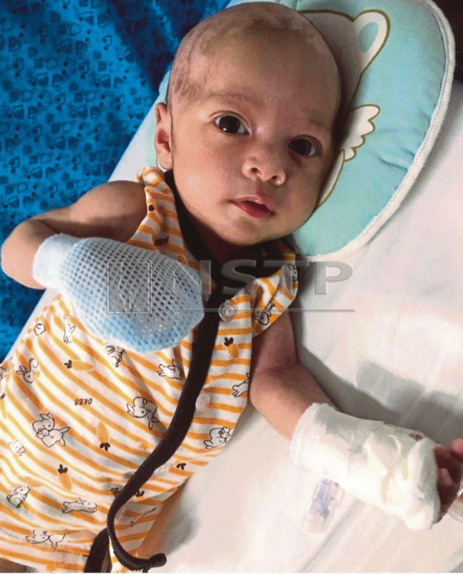 MUHAMMAD  Azzam Fahmy  menghidap kanser neuroblastoma tahap tiga.