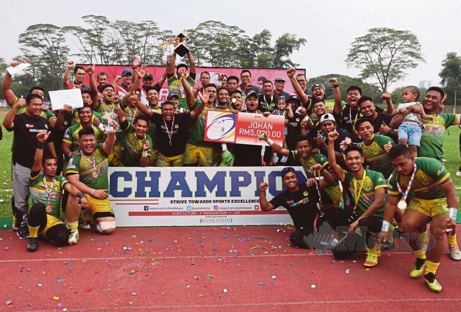 PEMAIN Serdang Angels meraikan kejayaan muncul juara.