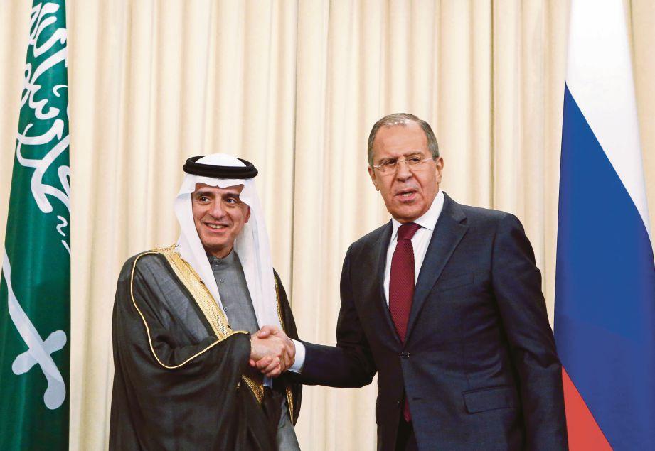 ADEL (kiri) bersama Lavrow di Moscow, semalam. - AFP