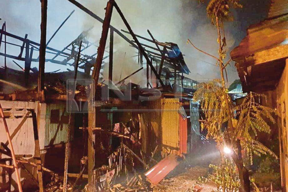 RUMAH pusaka keluarga Hasmi Marina di Jalan Gajah Mati tinggal rangka selepas hangus terbakar.