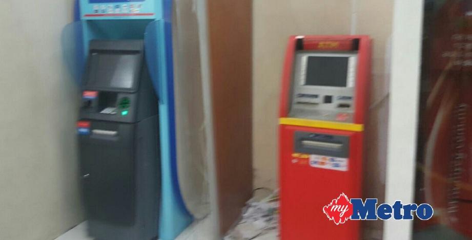 ALAT penggera keselamatan berbunyi menyebabkan cubaan menyamun mesin ATM gagal. FOTO ihsan pembaca