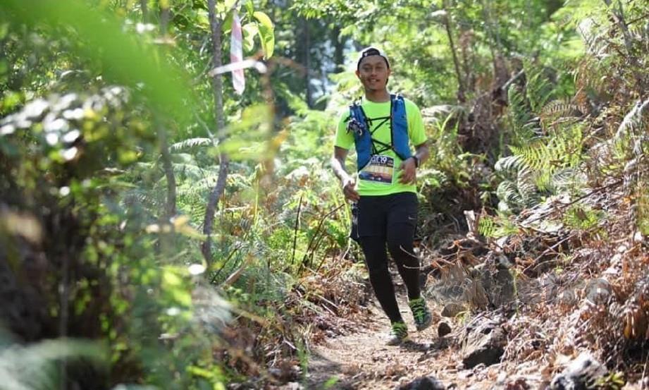 GAMBAR Mohamad Ashraf Hasan,29, dirakam ketika menyertai larian Gopeng Ultra Trail di kawasan Gunung Tempurung, Gopeng, Perak, Sabtu lalu sebelum hilang. FOTO NSTP