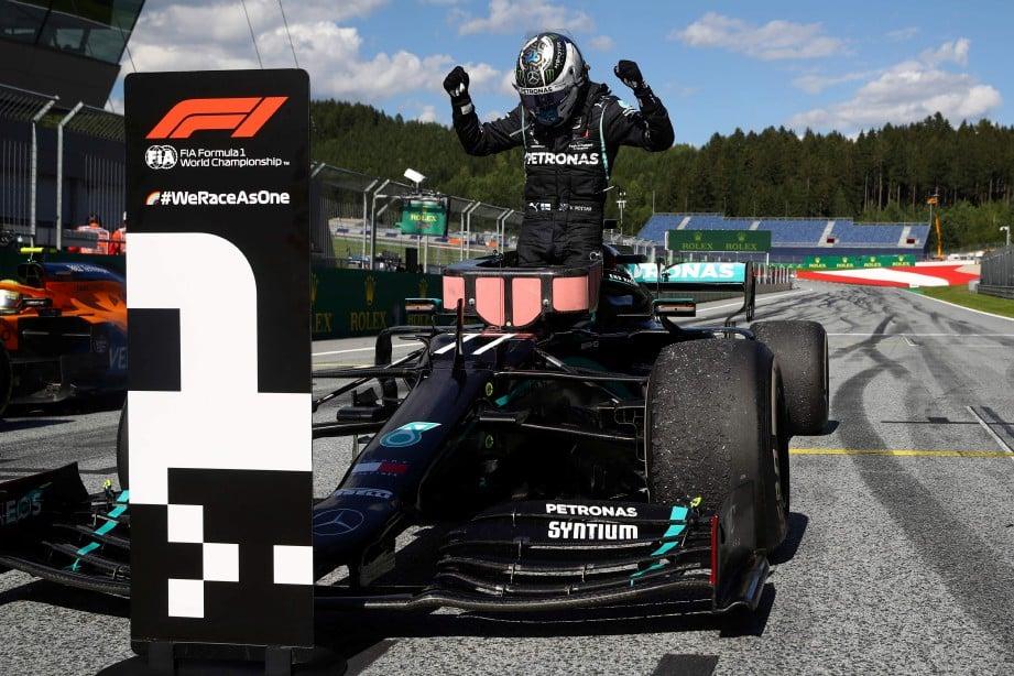 BOTTAS meraikan kejayaan selepas muncul juara di GP Austria. FOTO AFP