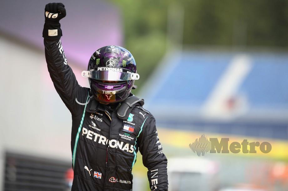 HAMILTON meraikan kejuaraan sulungnya musim ini di GP Styrian. FOTO AFP