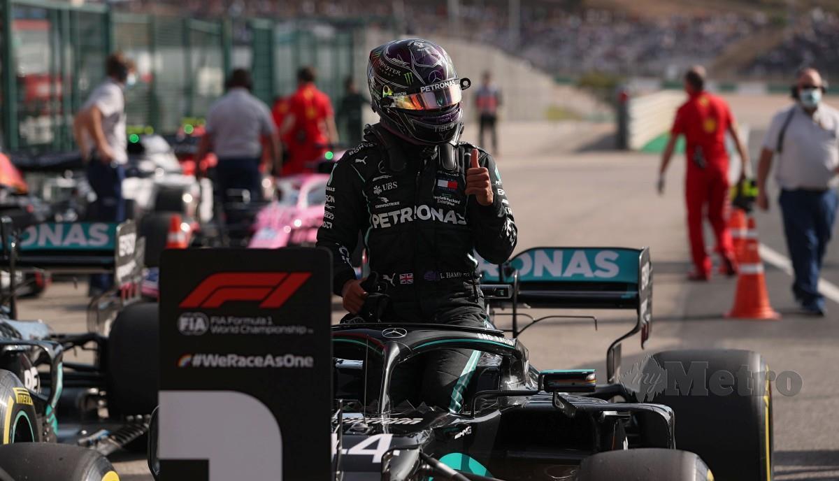 HAMILTON berjaya meraih petak utama di GP Portugal. FOTO AFP