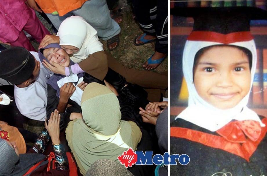 NOR Habibah pengsan dan segera diberi bantuan oleh anggota keluarganya sejurus jenazah anaknya Nureen Ain Juwita (kanan) dikebumikan di Tanah Perkuburan Islam Sungai Karang Darat. FOTO Bernama