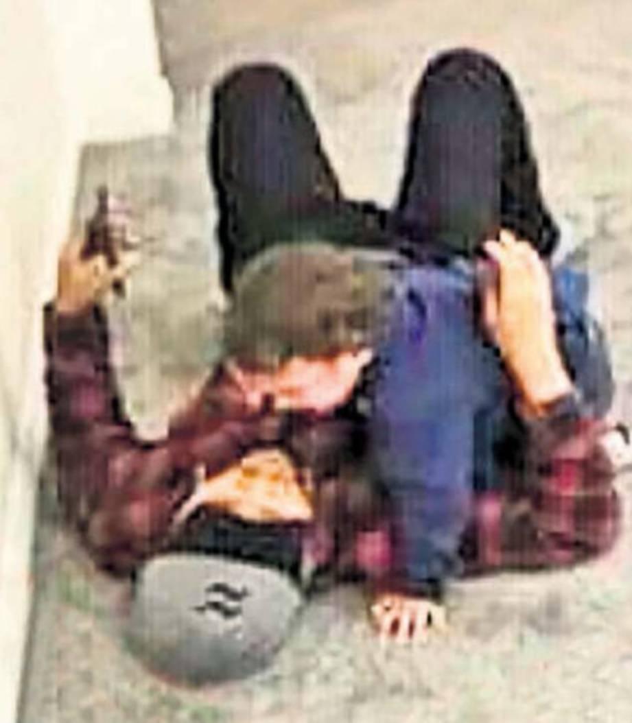 AVERROES dan bapanya Zulfirman yang cedera ditembak. FOTO Daily Mail