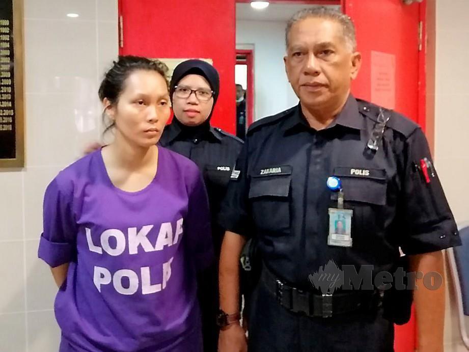 NORAZLIN dijatuhi hukuman penjara tiga bulan dan denda RM1,000 kerana mencuri 40 helai kain batik. FOTO Zatul Iffah Zolkiply
