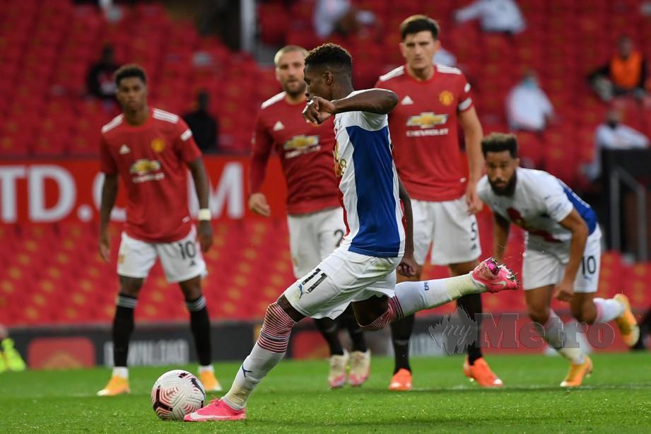 Zaha meledakkan dua gol untuk membantu Palace menewaskan United. FOTO AFP