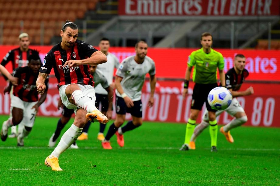 AKSI  Ibrahimovic meledak penalti di Stadium San Siro. FOTO AFP