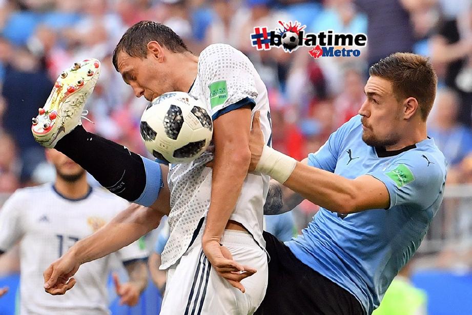 COATES (kanan) ingatkan rakan sepasukan untuk mengekang pemain Portugal selain Ronaldo. FOTO/AFP