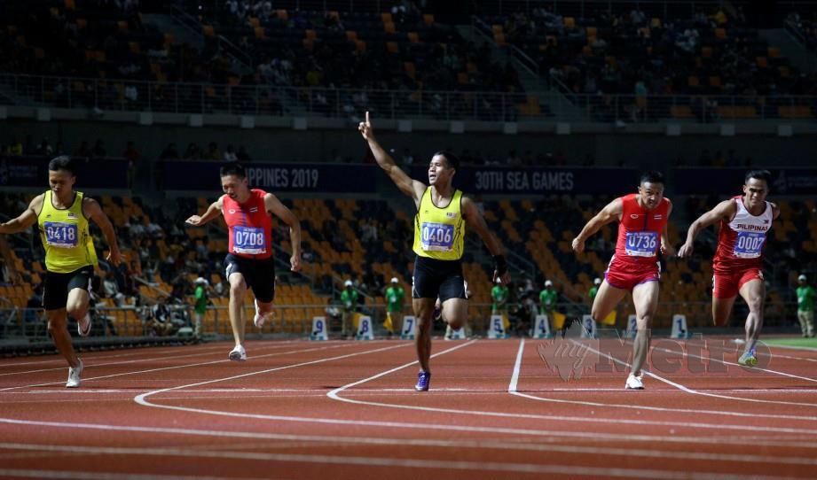 AKSI Haiqal Hanafi ketika acara pecut 100 meter.