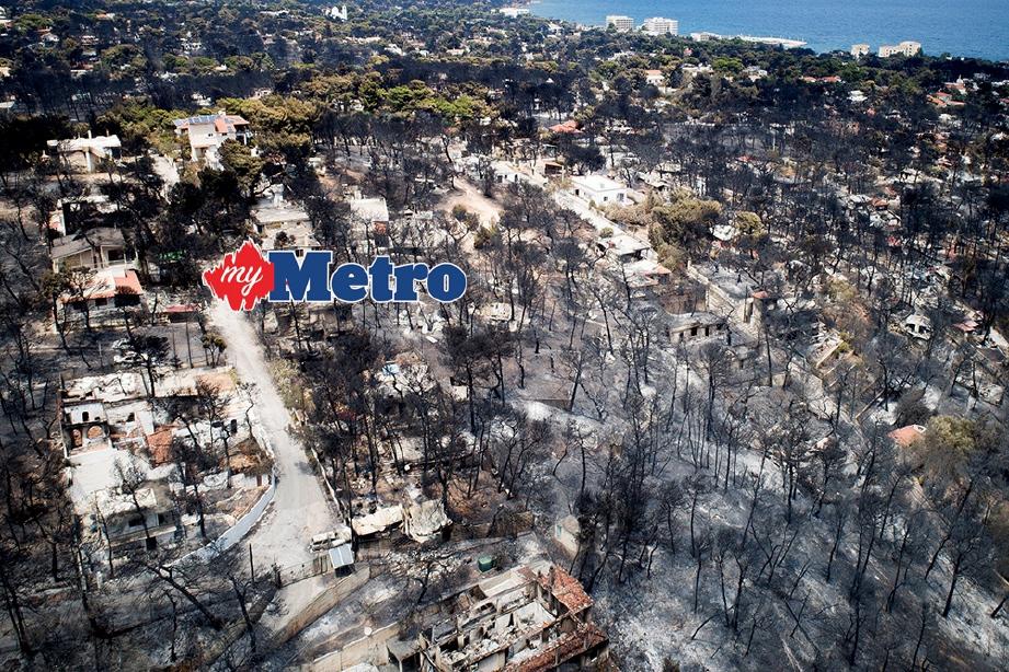 KEADAAN selepas kebakaran di sekitar Athens.  FOTO/AFP