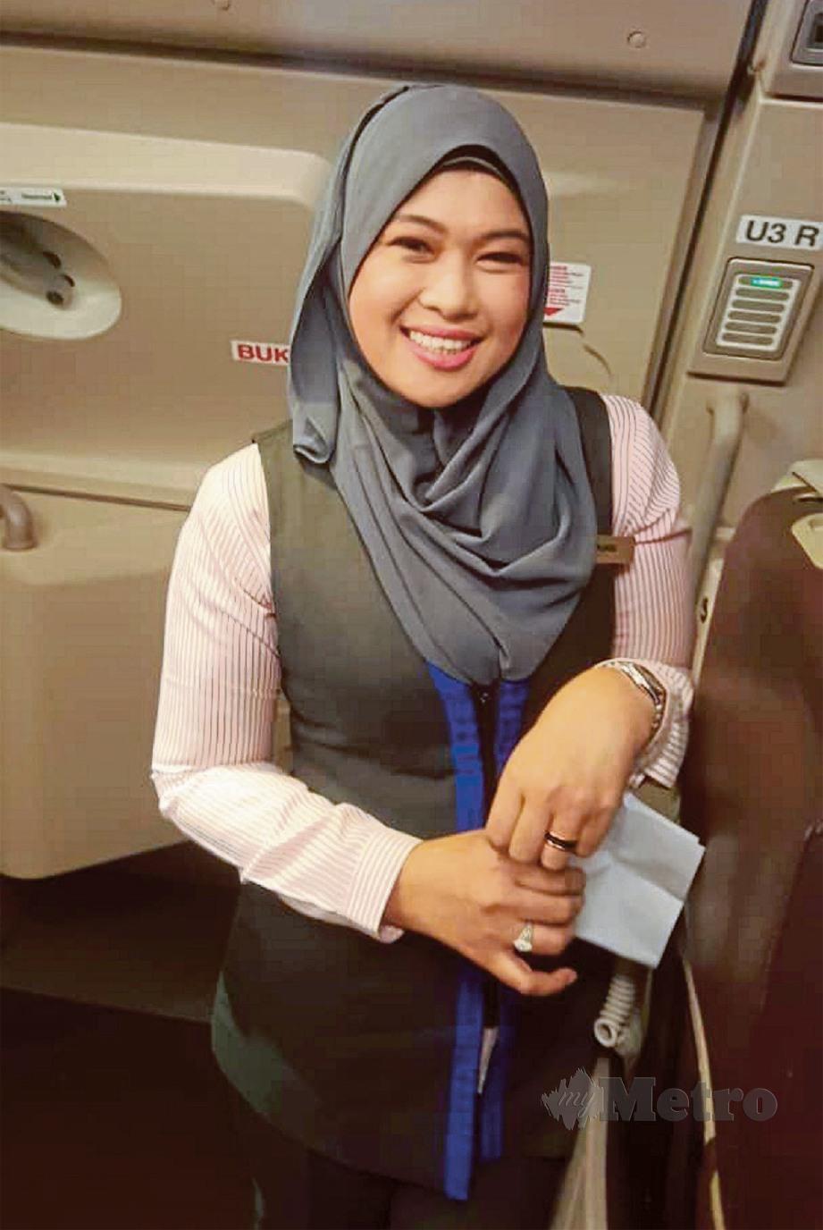 DIGELAR Kru Berhijab, pramugari Amal iaitu anak syarikat Malaysia Airlines Berhad yang khusus untuk penerbangan sewaan umrah dan haji, Norlinda Mohd Noor, 43. FOTO Yusri Abdul Malek