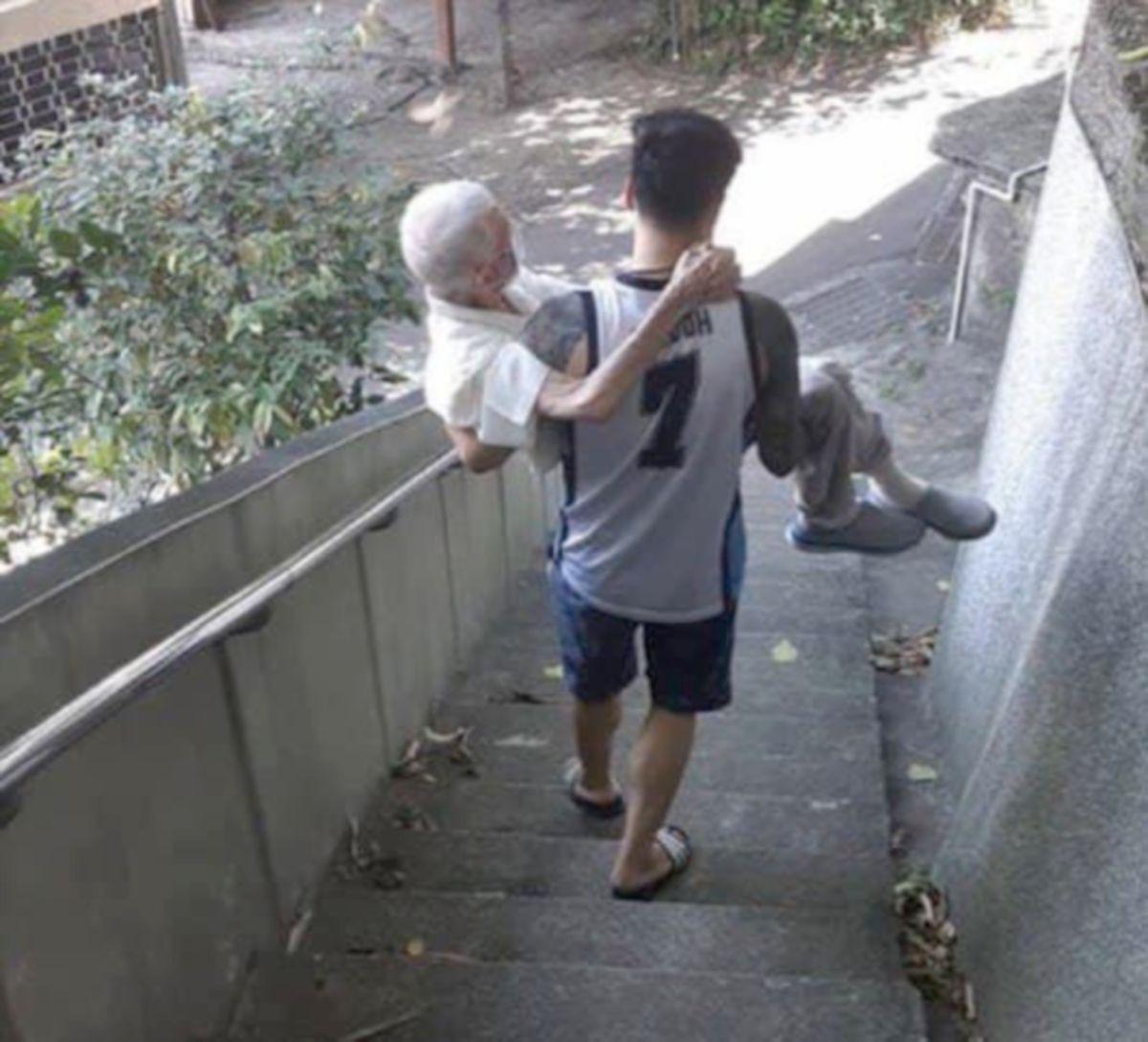 GAMBAR pemuda yang menggendong datuknya tular di media sosial.