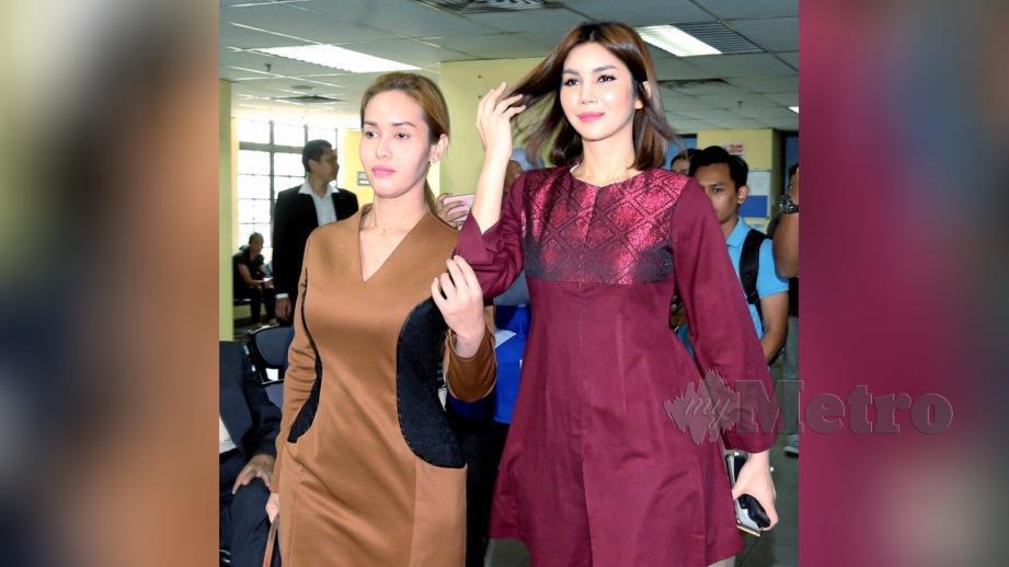 NUR Sajat (kanan) keluar dari mahkamah selepas mengaku tidak bersalah atas tuduhan memiliki 19 produk kecantikan tidak berdaftar dengan KKM. FOTO Zain Ahmed