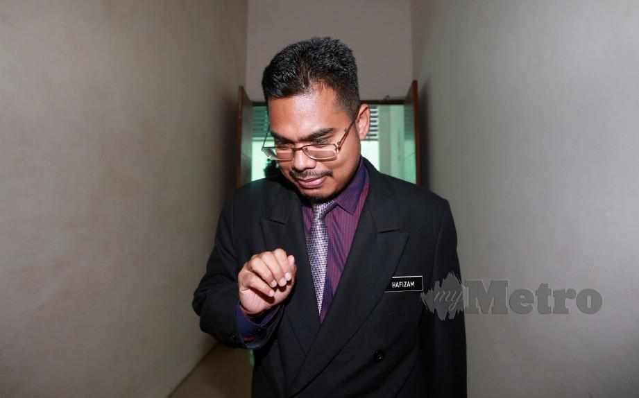 SAKSI ke-24, Pakar Perubatan Forensik Hospital Kuala Lumpur, (HKL) Dr Ahmad Hafizam Hasmi hadir untuk inkues menentukan punca kematian anggota bomba, Muhammad Adib Mohd Kassim di Kompleks Mahkamah Shah Alam. FOTO Sairien Nafis