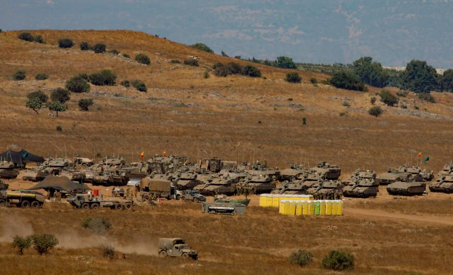 KENDERAAN tentera rejim Israel dilihat berhampiran kawasan Bukit Golan yang dikuasai Israel berhampiran sempadan Syria. FOTO AFP