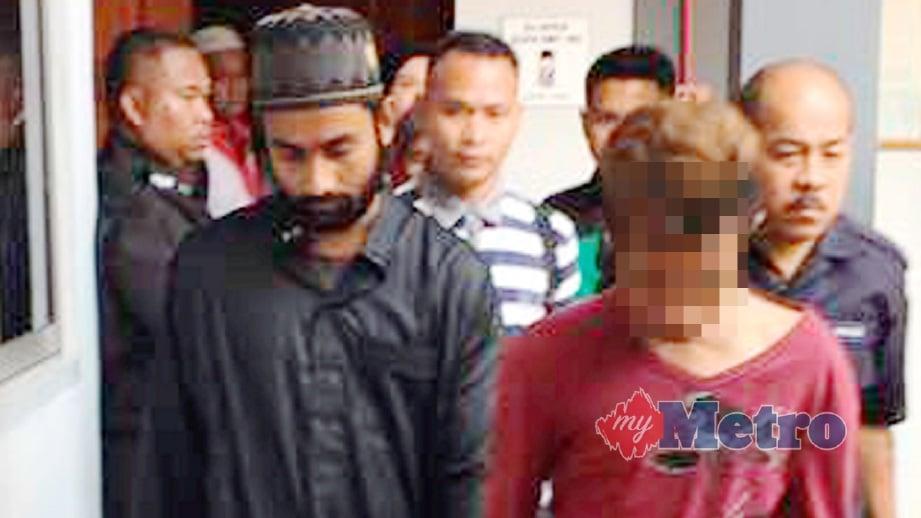 USMAN Shafie (kiri) didakwa di Mahkamah Sesyen Kota Bharu. FOTO Siti Norhidayatidayu Razali