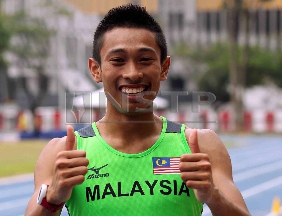 KHAIRUL Hafiz gembira dengan catatan masa dilakukan Azeem dalam acara 100 meter.