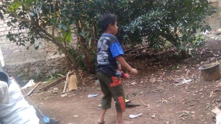 RIZKI minat bermain dengan kodok dan ular sebelum bunuh haiwan berkenaan. FOTO Tribunnews