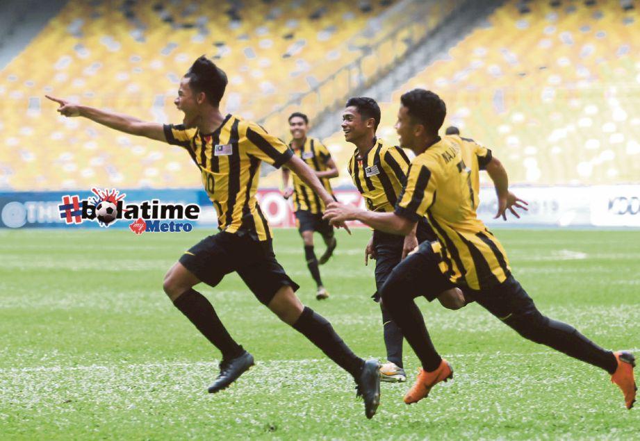 LUQMAN meraikan jaringan gol ketika menentang Tajikistan pada perlawanan AFC U-16 Championship Malaysia 2018 di Stadium Negara Bukit Jalil. FOTO/EIZAIRI SHAMSUDIN