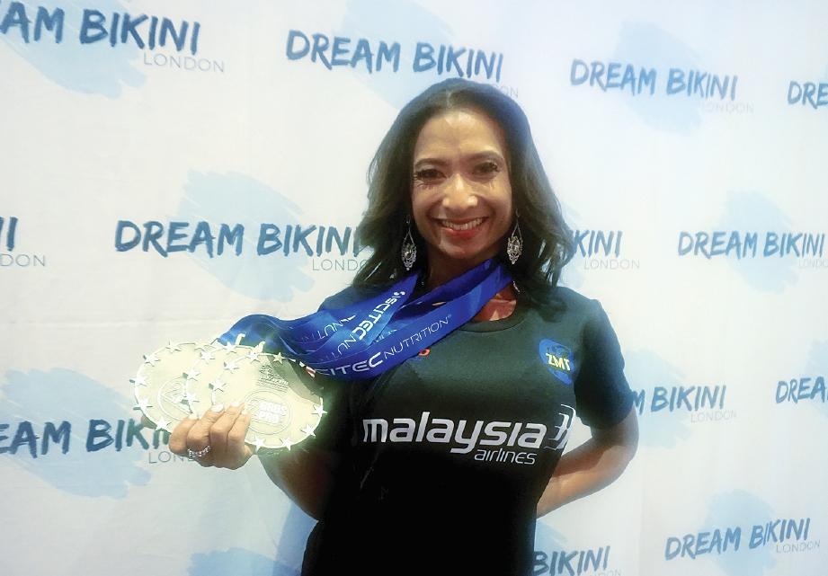 KOMITED dalam latihan menjadikan Dr Aisyah sebagai atlet bina raga berjaya. FOTO Ihsan Dr Aisyah Asmadi