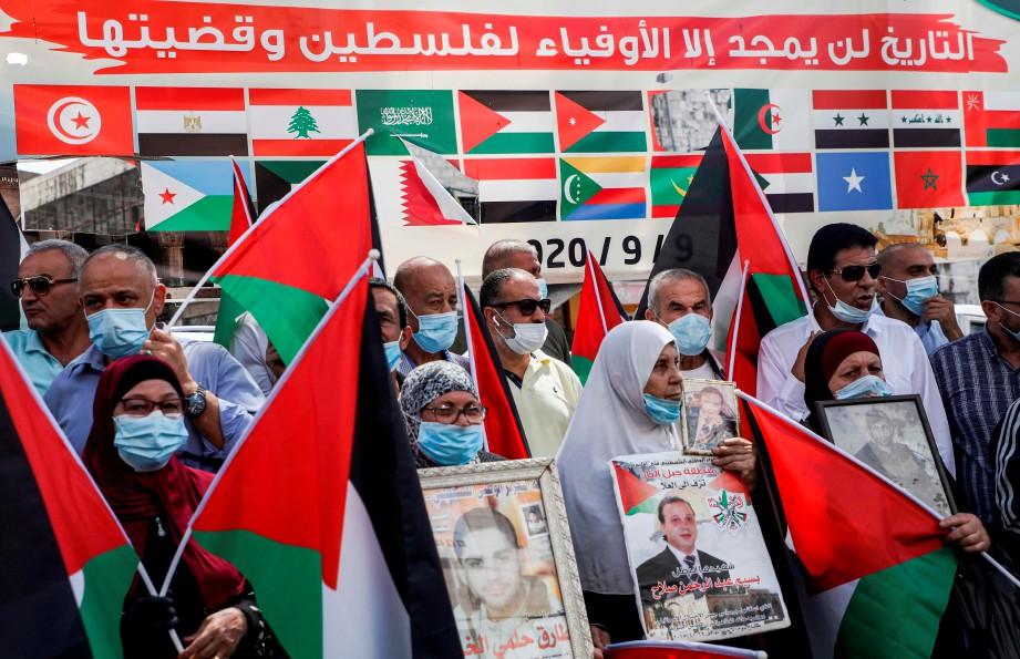 PESERTA demonstrasi berkenaan. FOTO AFP