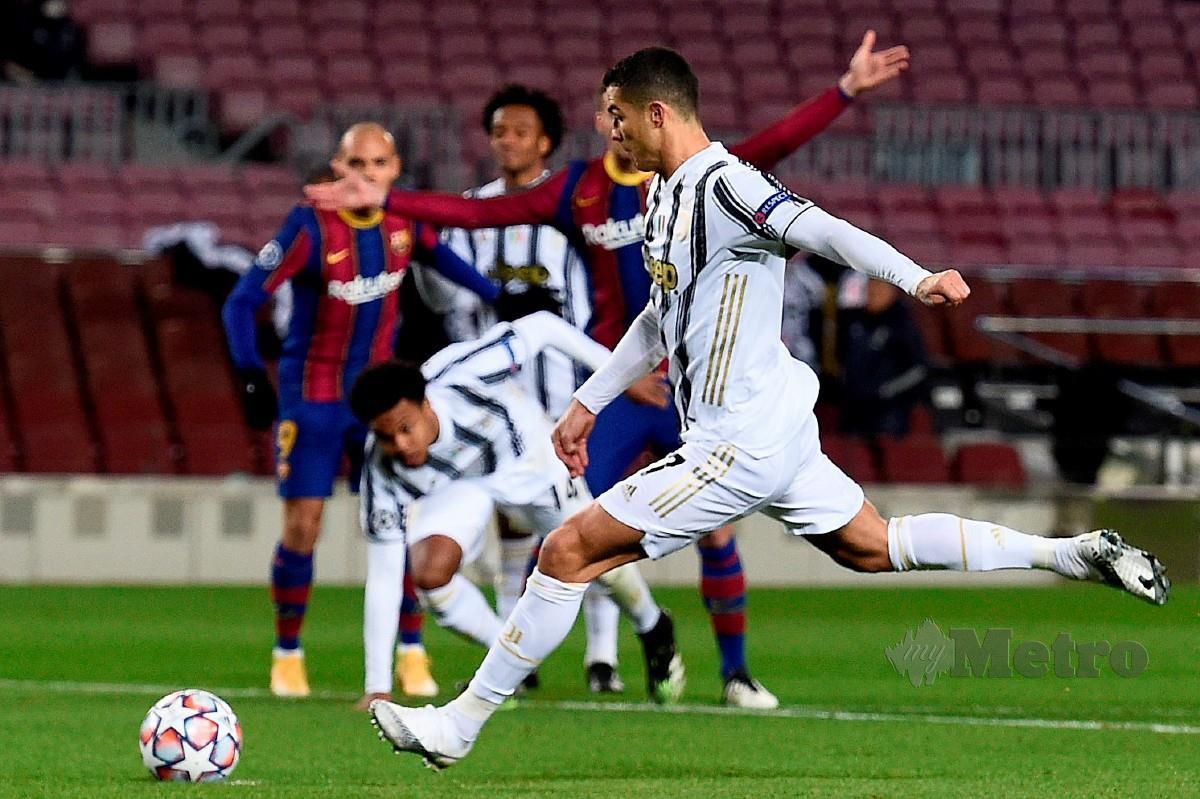 Dua gol penalti disempurnakan Ronaldo memastikan Juventus menewaskan Barcelona. FOTO AFP