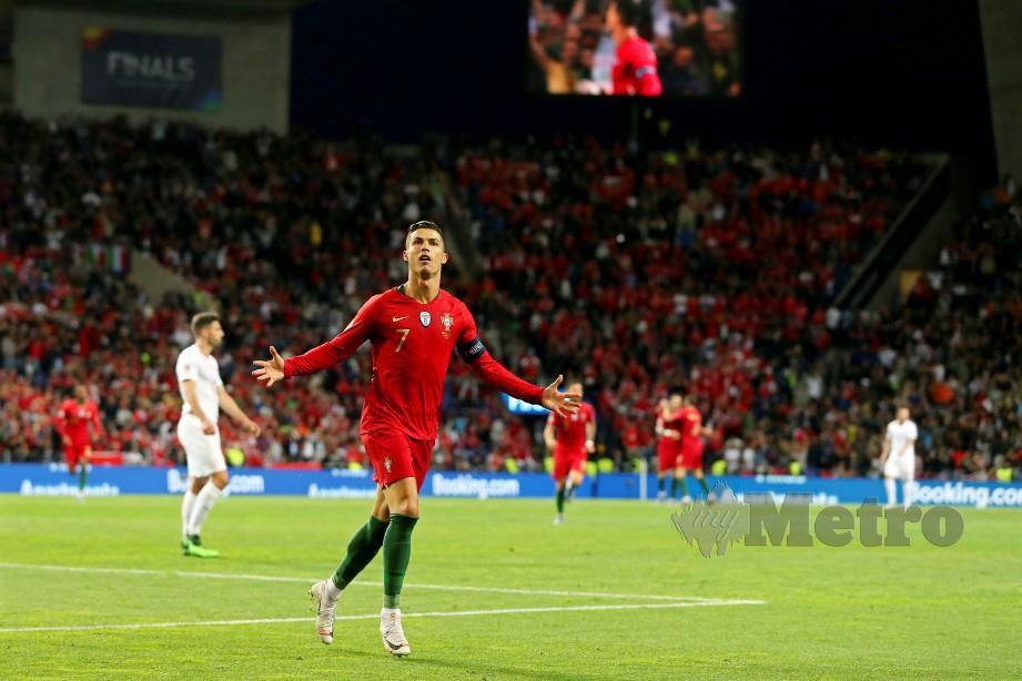 Ronaldo meraikan jaringan ketika bertemu Switzerland pada aksi Liga Negara-Negara Eropah. FOTO EPA.