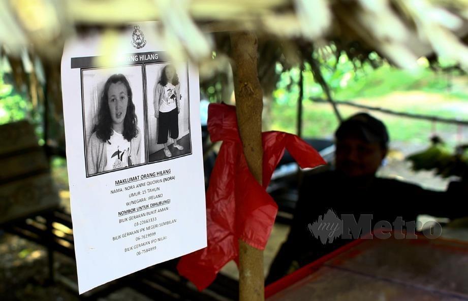 POSTER wajah Nora Anne ditampal di sekitar kawasan berhampiran lokasi dia dilaporkan hilang. FOTO Adzlan Sidek