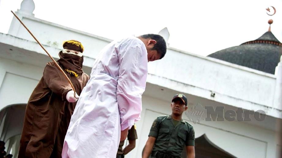 HUKUMAN yang dilaksanakan di Aceh. FOTO hiasan