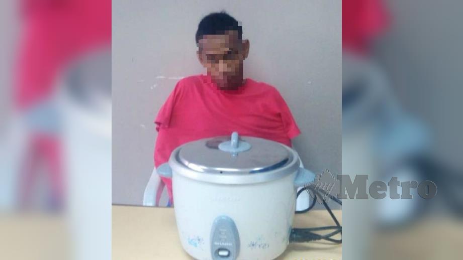 PERIUK Nasi elektrik dan suspek yang ditahan. FOTO Ihsan Polis.