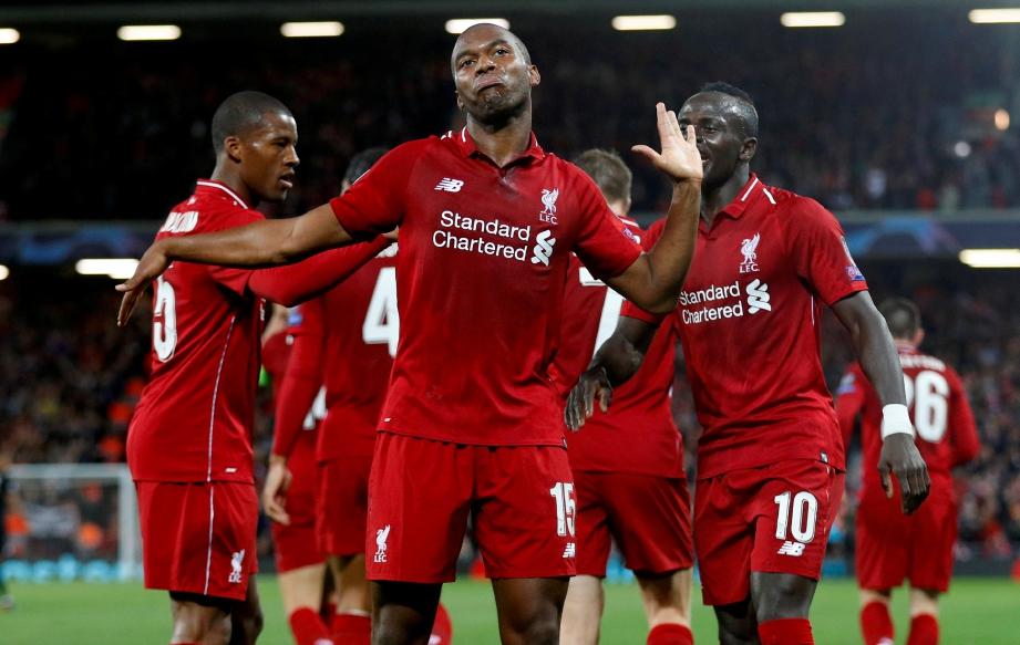 PEMAIN Liverpool, Daniel Sturridge meraikan jaringan bersama rakan sepasukan ketika menentang PSG di Stadium Anfield. FOTO Reuters