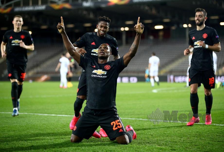 GAYA Ighalo meraikan gol pertama United. FOTO Reuters