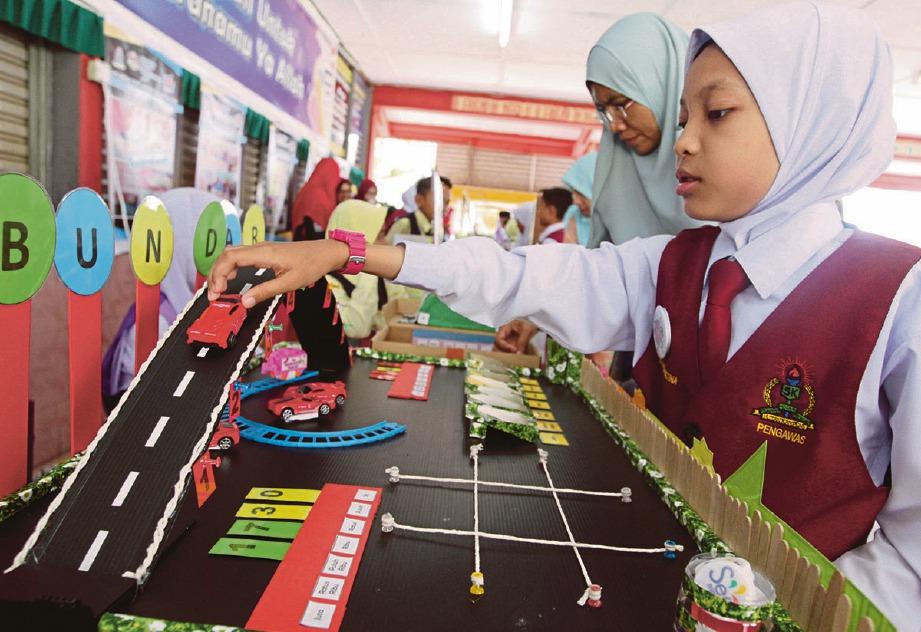 PEMBELAJARAN STEM berbentuk secara langsung untuk menarik pelajar terhadap sains dan matematik. FOTO Sharul Hafiz Zam